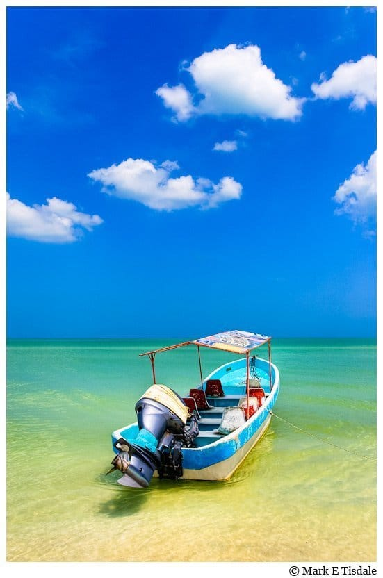 Picture of a little boat in the beautiful waters of the Gulf of Mexico in Celestún Yucatan