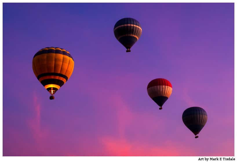 Beautiful violet skies frame this picture of Luxor Hot Air Ballons