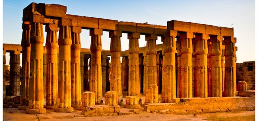 Beautiful golden hued photo of the ruins of Luxor Temple in Egypt