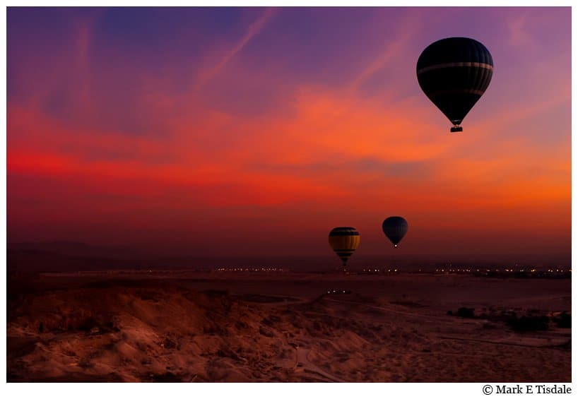 Valley of the Kings photo of hot air balloons in the pre-dawn skies - fiery red