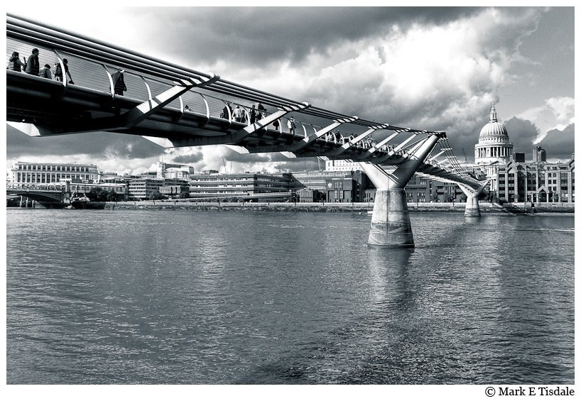 Dramatic Picture of St. Paul's Cathedral and the modern Millenium Footbridge