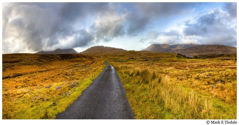 Panorama Photo of a road heading to the horizon in the landscape of Connemara