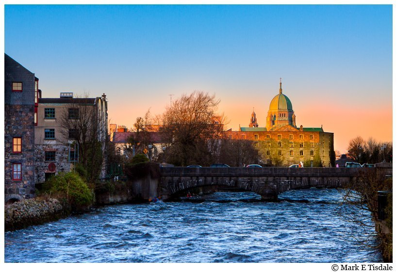 Photo taken of the river Corrib in Galway Ireland - the cathedral dome is prominent