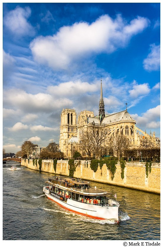 River Seine boats photo withe the Notre Dame de Paris Cathedral in the background
