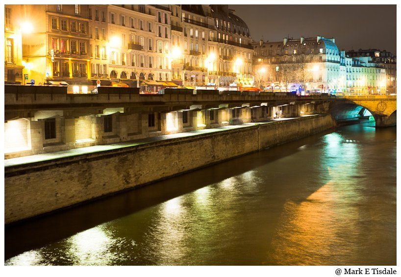 Parisian Picture of the Seine at night and the buildings overlooking the river