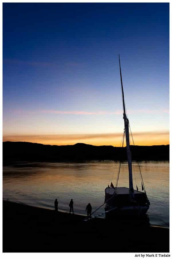 Dawn On The River Nile With an Egyptian Felucca in Silhouette - Print by Mark Tisdale